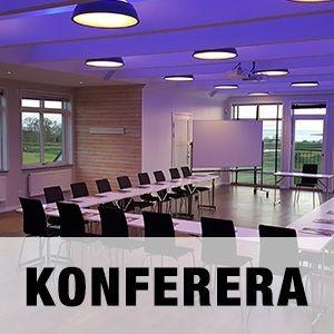 """Bild på ett av Golfarenans konferensrum med texten """"KONFERERA""""."""