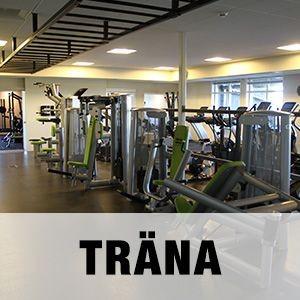 """Bild på Golfarenans Gym med texten """"TRÄNA""""."""